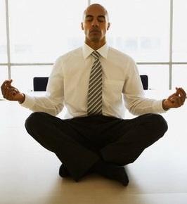 Man meditating in office