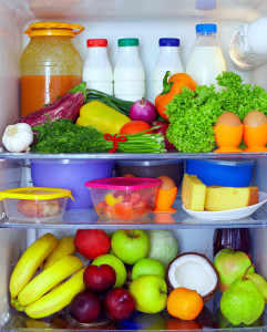 refrigerator full of healthy food. fruits, vegetables