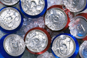 Photo of cans of drink on crushed ice.